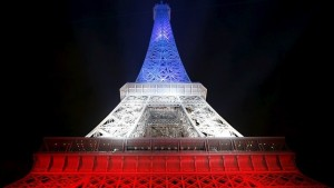 The Eiffel Tower is lit with the blue, white and red colours of the French flag in Paris a week after a series of deadly attacks in the French capital
