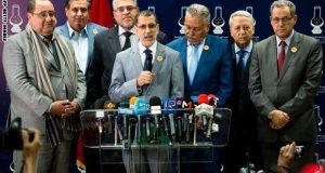 Morocco's new Prime Minister Saad-Eddine El Othmani (C) gives a press conference as Driss Lachgar (L), Presidnet of the Socialist Union of Popular Forces party (USFP), Aziz Akhannouch (2ndL), President of the National Rally of Independents (RNI), Mohamed Nabil Benabdallah (3rdR), President of the Progress and Socialism party (PPS) , Mohammed Sajid (2ndR), President of the Constitutional Union (UC), and Mohand Laenser (R), President of the Popular Movement party (MP) stand at the headquarters of the Islamist Justice and Development Party (PJD) in Rabat, on March 25, 2017. Saad-Eddine El Othmani announced the formation of the new coalition government which will include ministers from the National Rally of Independents (RNI), the Popular Movement (MP), the Constitutional Union (UC), the Party of Progress and Socialism (PPS) and the Socialist Union of Popular Forces (USFP). / AFP PHOTO / FADEL SENNA (Photo credit should read FADEL SENNA/AFP/Getty Images)